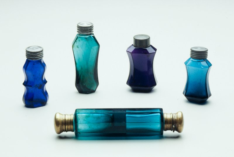double perfume bottle (cap at each end), green glass