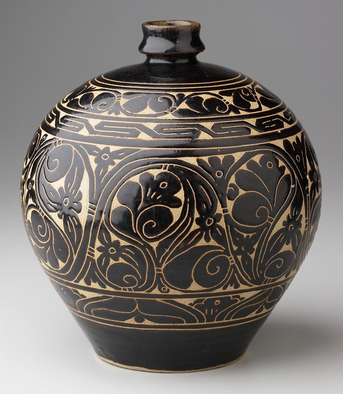 brown glaze; wide shoulder with short narrow neck; 4 bands of cut away (sgraffiato) decoration (from top) leafy scroll, key-fret, floral with twisting vines, stylized leaves and flowers; has fitted blue box