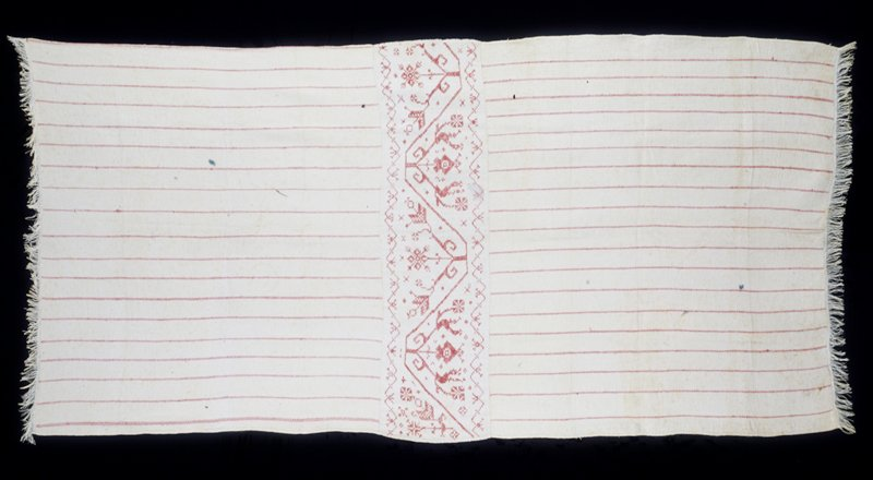 tablecloth, white linen woven with red stripes, central panel embroidered with geometric floral motif in cross stitch