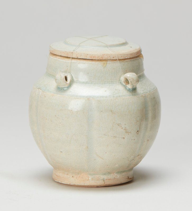 covered jar fluted body with four loop handles; porcelain with aqua glaze