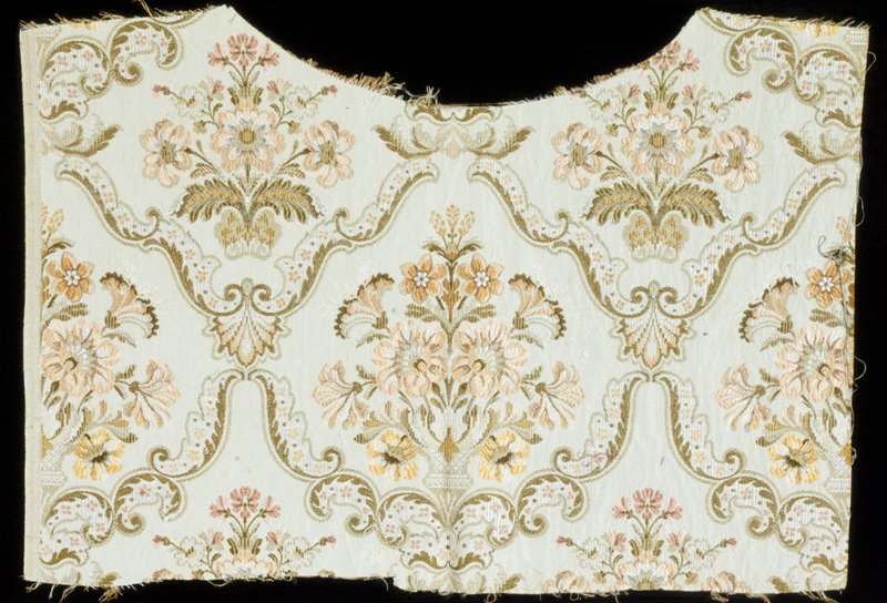 from a chair back upholstery; floral design in pink, peach, green, on beige ground; patterned silk