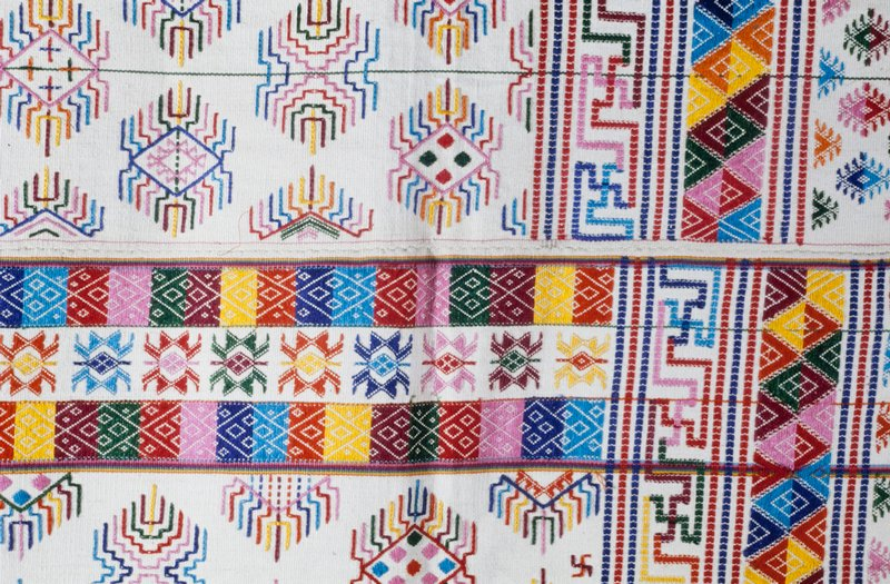 Kira, Kushotara; silk/cotton brocade on white background; L.104 in., W.52 in. 3 panels; multicolored supplementary weft design on natural ground; red, blue, yellow, green stripes at selvedge; fringe.