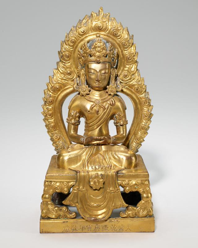 one of pair of Bodhisattvas crowned, seated in Dhyana (meditation) mudra on thrones with flame halo; gilt bronze