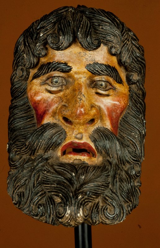 mask, wood, painted; Concave profile, carved and lined beard and hair. Subject is of Santiago performer (patron saint of Cortes) in a variation of the Dance of the Moors and Christians.