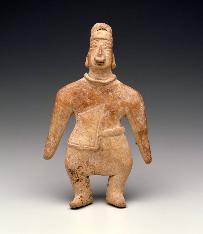 Standing Male Figure, flat, solid, cape on right side, applique headdress, noseplug, necklace abd diamons eyes. Burnished buff clay. West Mexican (Colima) 100 B.C.- 300 A.D.