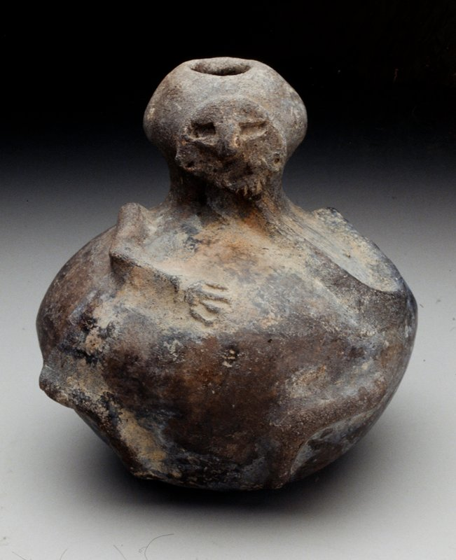 Human Effigy Bowl, clay with burnished black slip, West Mexican, n.d; Face on top, applique arms on torso NO PHOTO ON CAT. CARD cat. card dims H 5-3/4'