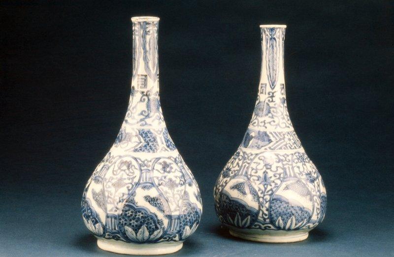 One of a pair of Point Neck Vases, porcelain, underglaze blue decor of flowers (83.113.7-8)