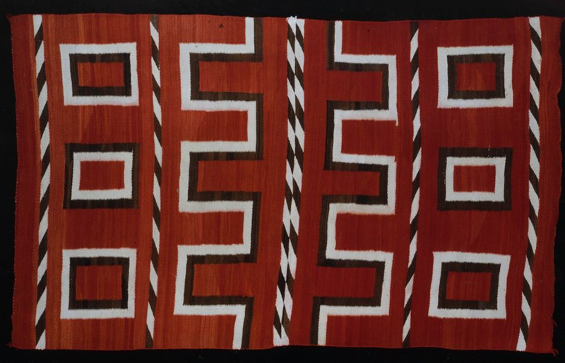 rug, c.1880, wool, brown, and neutral on red ground, geometric patterns, Ganado type.