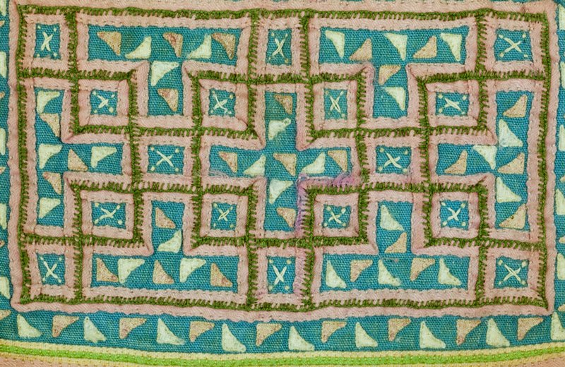 a and b: White Hmong; cotton with cross stitch embroidery in pinks and greens. Worn on back of women's blouses with design facing out; c and d: Blue Hmong; cotton, fold and tuck, applique in pumpkin seed pattern, vegetable blossom embroidery; worn on blouses with design facing down
