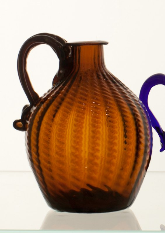 globular jug, golden amber, 24 ribs, left-hand broken swirl, ribbed strap handle, small cooling check under handle; attriburted to Zanesville; bottle and dishes from Ohio Manufacturers, 159 items in all, from the Walter Douglas Collection in Centerville, Ohio