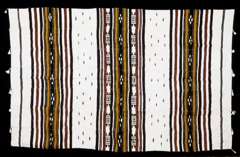 man's coverlet, wool and cotton with tassels (Bouki serra), African XXc stored in box; dims 76 x 35'; stored with 86.100.24,25 Name: Sakhalare. Used for great festivities and market days. Worn folded over left shoulder. S85-94.
