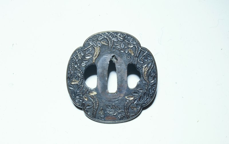 Copper alloy with traces of gold gilt; wisteria design on stipple ground.