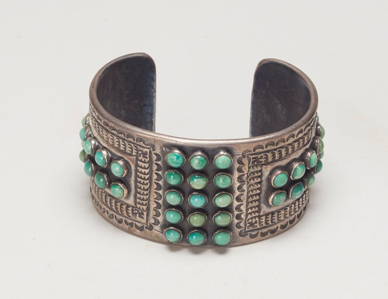 Bracelet; silver band with stamped design; 43 turquoise. J# 1080, No Cat#