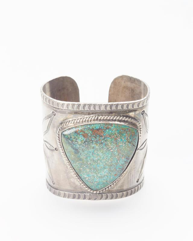 Sheet band; set with large triangular; stamped, repousse and twisted wire decoration; Wide band with shield-shaped turquoise and stamped design cat. 58