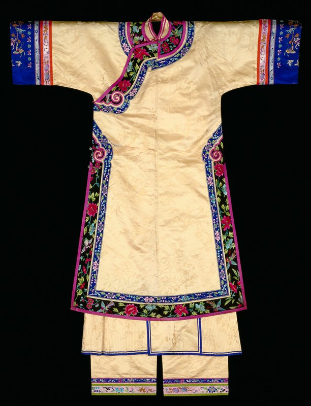 woman's three piece outfit consisting of robe, skirt and trousers of silk damask, embroidered satin and silk woven ribbon.