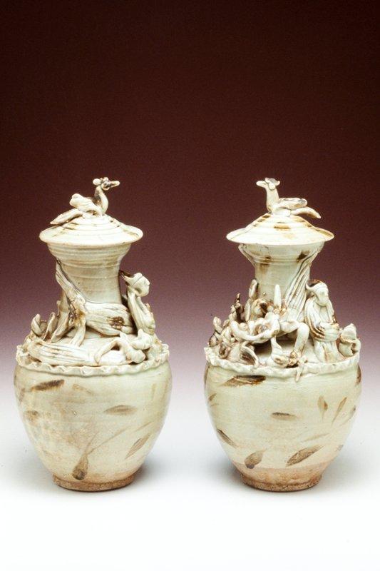 stoneware, ching pai and splashed iron glazes, molded decor