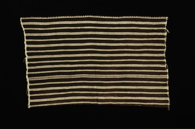 resist-dyed; Wele design: striped pattern of groups of two or three solid stripes, with one variation of two dashed stripes enclosed by two solid stripes; one lone edge is printed with a row of triangles.; natural and brown stripes; collected Dec.12,1986; made by Nampere