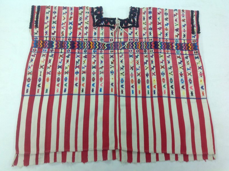 Two panel huipil, ground cloth of red and white stripes; white stripes filled with woven and embroidered? multicolored zoomorphic and geometric designs; black rickrack? around neck and arm holes.