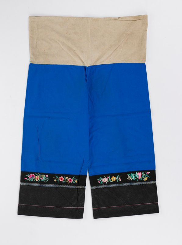 bright blue cotton, beige cotton at waist, woven, embroidered, charcoal plain weave bands at bottom of each pant leg