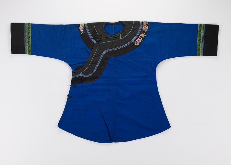 blue and black cotton, woven and embroidered decorative bands at sleeves, neck and front