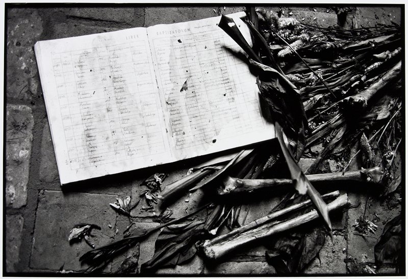 baptism book with bones and flowers