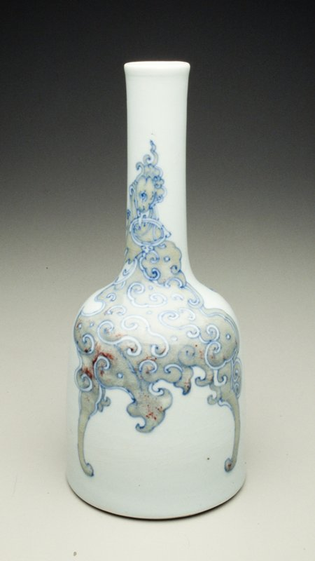 mallet-shaped, 'Kanxi', peachbloom, ble and white, each side with archaistic phoenix holding ring handle in beak on narrow neck and spreading bat-like wings onto lower part; peachbloom body with areas of bright red, outlined in underglaze blue under varied and deep crackle
