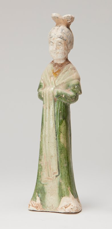 ceramic standing royal female attendant with top knot; green and brown glaze
