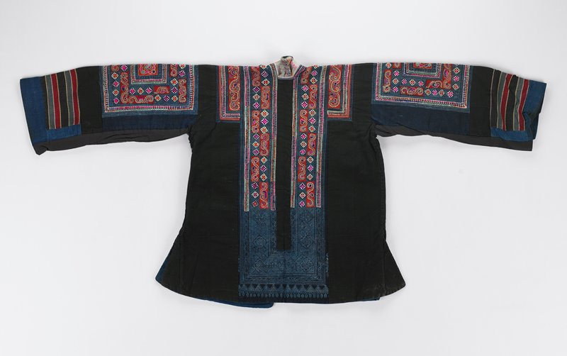 black collar; batik shoulder panels, central back and band around collar with elements of patterning done over in embroidery