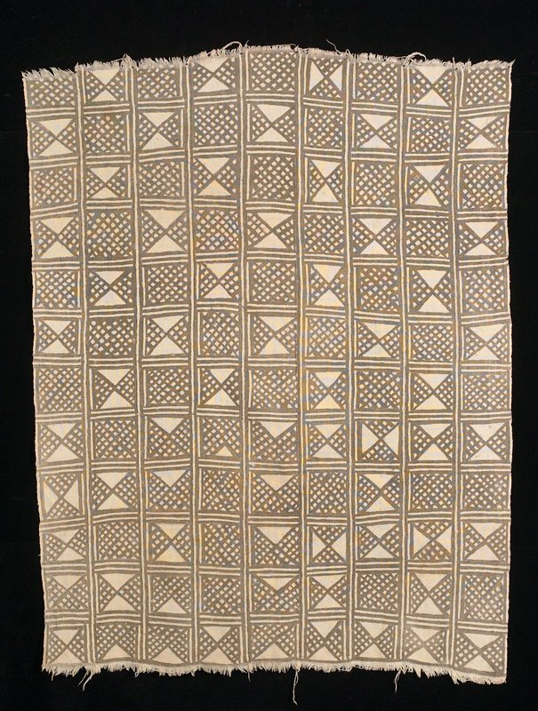 nine panels; beige field with alternating checkerboard pattern of lattice design and open triangle and lattice designs; checkerboard break down at one side. Surface ornamentation (Dyed)