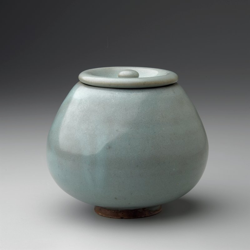 lotus bud form jar with cover in green/blue glaze; stored in wood box