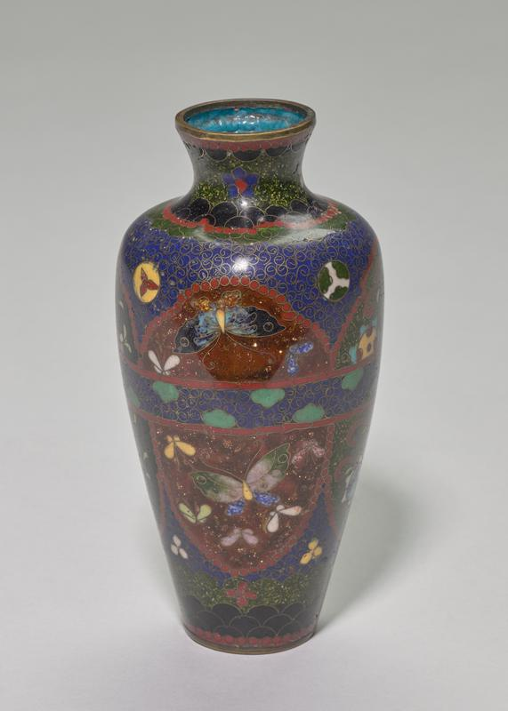 brass rim and foot; multiple colored grounds of blue, green, black and red with glittering cinnabar; four decorative fields alternating in butterfly or flower design with a band running through the middle of the body; light blue interior