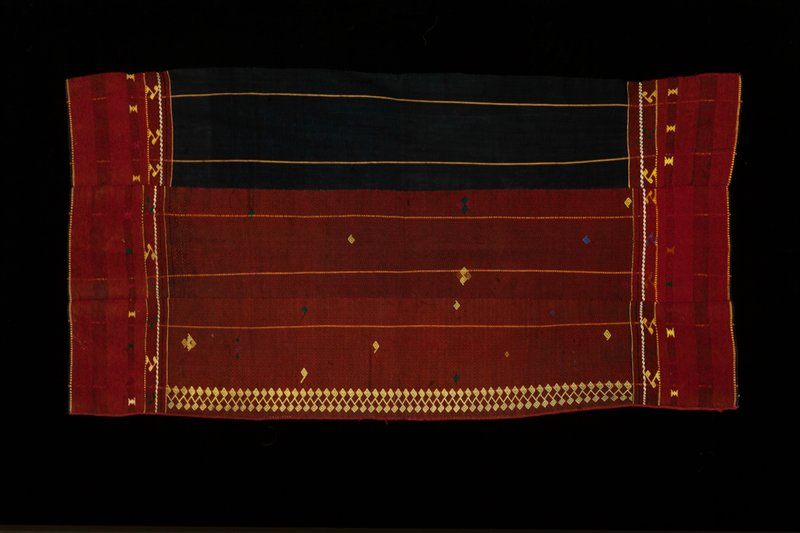 wool twill and broken twill; plain weave cotton; supplemental weft; three panels; black, red, yellow, green; left edge bound with red cotton