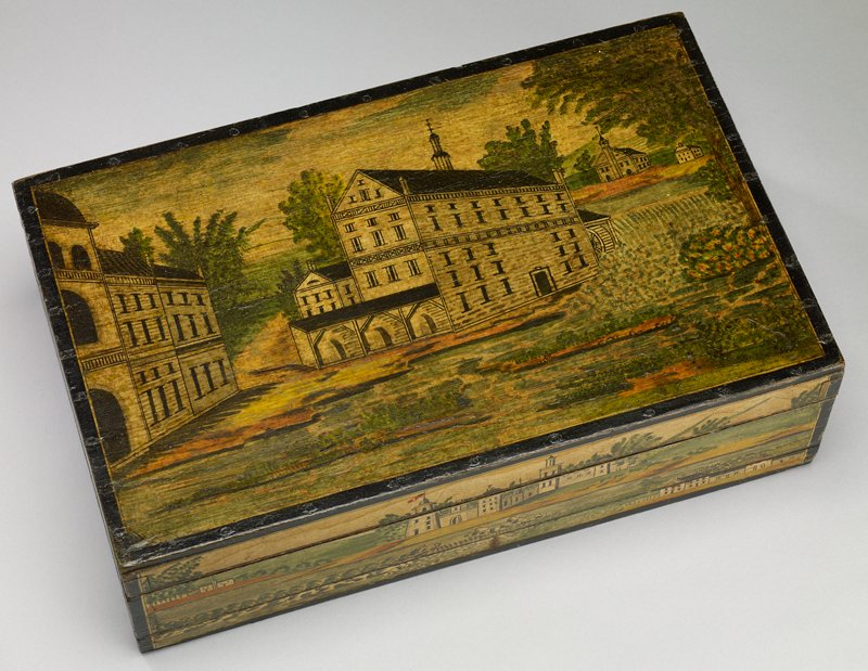 wooden box with hinged lid and removable tray with compartments; painted on the exterior with buildings and landscapes; a mill is painted on the lid; lid and interior tray lined with paper