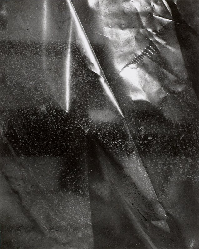 abstract design with plastic sheet with dirty water spots and wrinkles; mounted on board
