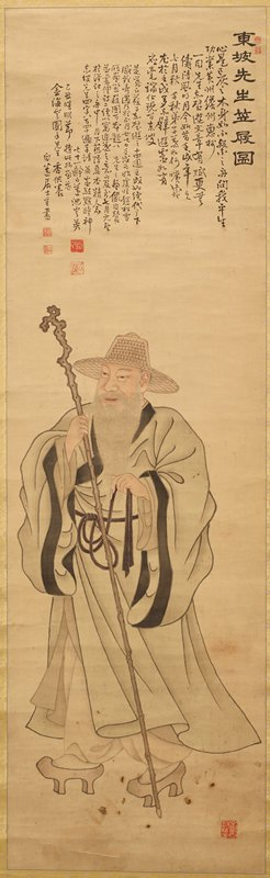 striding man with long white beard and long nails wearing flowing grey garment and straw hat and holding a tall walking stick