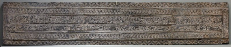 Tomb tile, grey earthenware with impressed decor. Decorated lintel from tomb excavated north of Loyang during the 1940's. Two bands of decoration a.showing mounted hunters with bows and arrows aiming at tigers b.dragon frieze. Geometric borders refer to silk patterns.