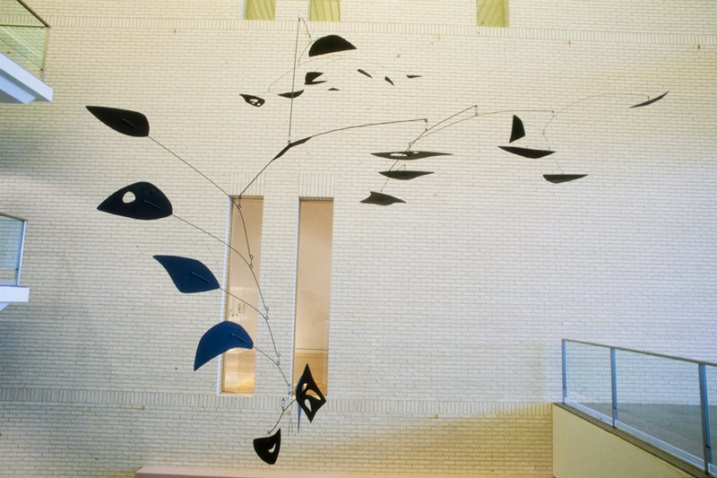 "hanging painted metal mobile; comprised of a series of bent steel rods (5 distinct gauges ranging from 1/8"" to 5/8"") with aluminum-alloy (est) sheet metal paddles and one steel paddle of varying sizes; the components are assigned letters from a-f in order of installation; ""a"" has one paddle and two rods; ceiling anchor point is at the middle of the primary rod; paddle is incised ""UPPER"" on the top side; ""b"" is a single rod; ""c"" has eight paddles and seven rods; ""d"" has seven paddles and six rods; ""e"" has three paddles and three rods, staggered; the paddles are incised ""5,"" ""6,"" and ""7; also ""Ahab"", artist's initials, and year are incised onto paddle ""6;"" ""f"" has four paddles and three rods, and a hanging u-shaped element; paddles are incised ""1,"" ""2,"" ""3,"" and ""4;"" the lowest hanging paddle is steel and the number is punched into the surface with awl or similar tool; the components are connected to one another with a series of rings, S-hooks, and rivets, allowing movement when the mobile is suspended; all parts of the mobile are painted with black matte paint"