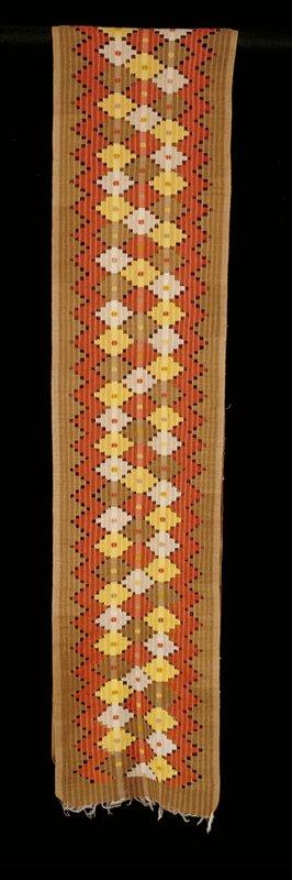 woven fabric; open weave in geometric motif; natural, orange, green, yellow, white