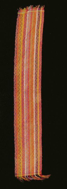 woven fabric; stripes of alternating colors red, orange, green, navy, blue, purple, yellow, white with repeating pattern; large stripes; zig zag motif; small stripes; stylized flowers