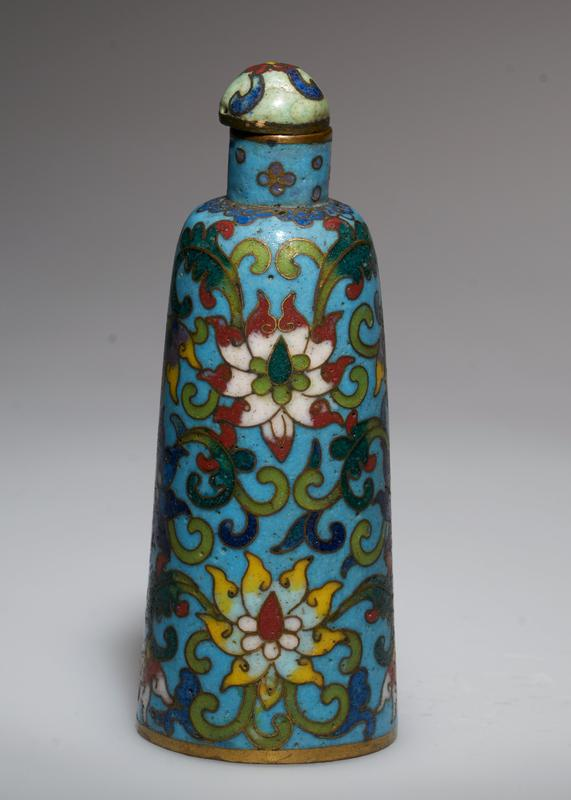 cloisonne top; geometric flower design on light blue ground. (27.1.79 and 27.1.80 are a pair).