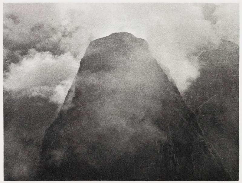 mountain peak surrounded by clouds