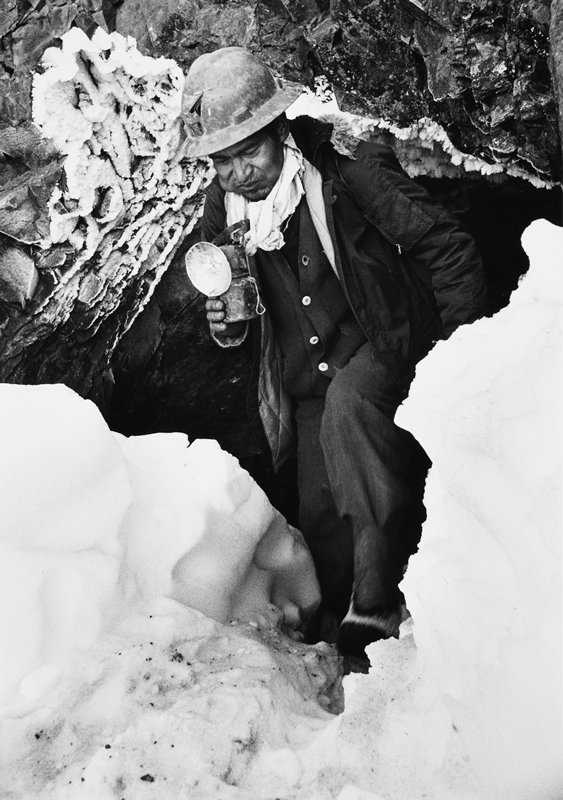 miner exiting a mine shaft; snow on the ground