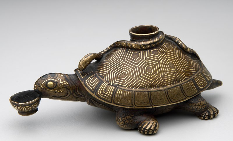 tortoise, with inlaid gold and silver, carrying a bowl in its mouth; snake on the back of tortoise's shell; hole on top
