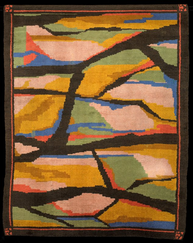 large brushed areas green, dust pink and gold on a brown background; some blue, orange, ochre touches; brown border lined with orange; at each corner same orange motif; natural brown wool weft woven between each row of pile; black wool edged the piece
