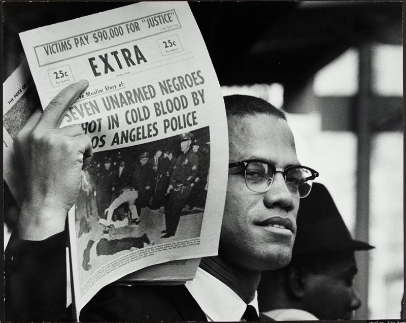 malcolm x holding up black muslim newspaper chicago illinois