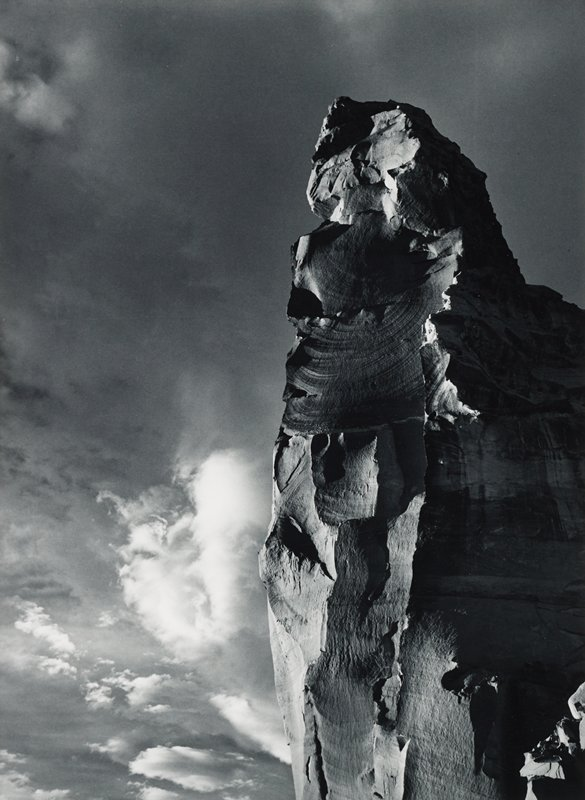 rock formation at right and clouds in LLC
