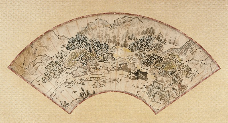 mounted fan painting: village buildings at C between rocky banks with clusters of full, mature trees; boulders and towering rock formations on either side; figure crossing bridge at LL; rocks in bay in foreground; mountains in background