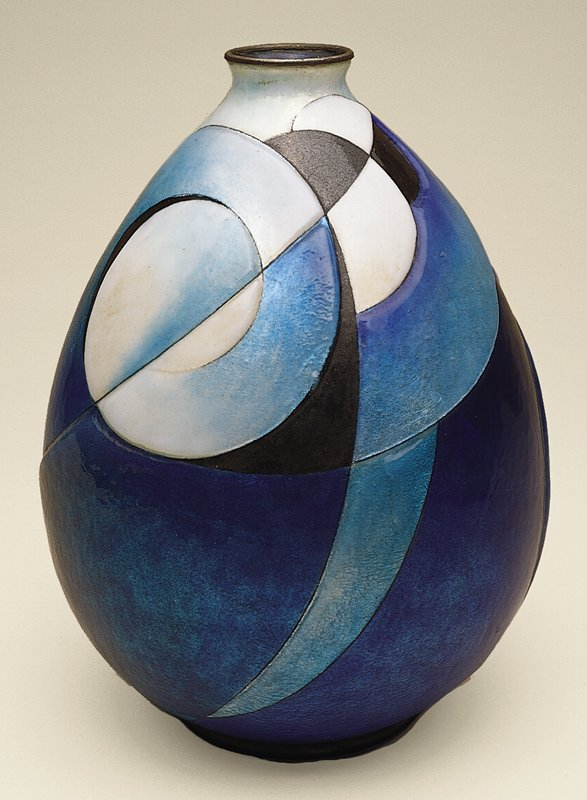 Pyriform vessel enameled in low and medium relief with arcs and circles in cobalt, turquise, gray-blue, white and black