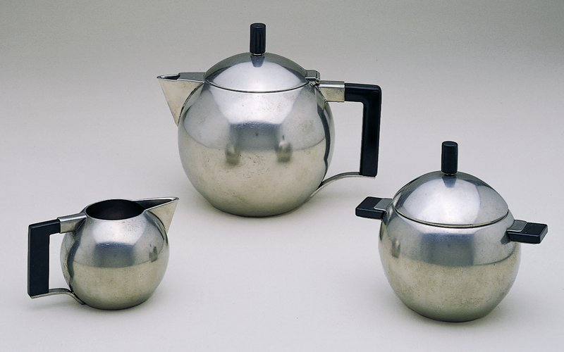 Spherical sugar bowl with black handles and finial