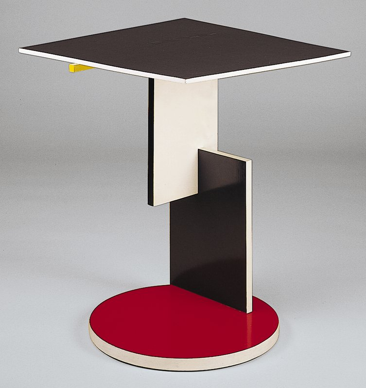 Deal, painted black, red, white, blue and yellow; round disc shaped base
